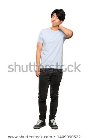 Man in blue shirt thinking stock photo © feedough