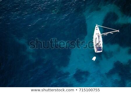Sailboat anchored in a bay  Stock photo © hraska