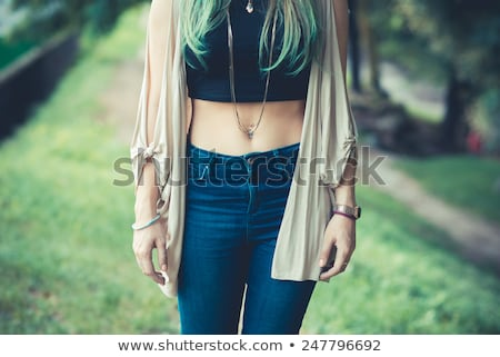 Girl belly with piercing stock photo © d13