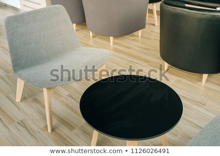 Four armchairs and round coffee table on a white background Stock photo © Serp