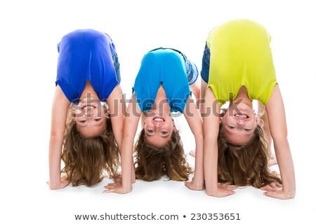 Gemelo nino hermanas simétrico flexible jugando Foto stock © lunamarina