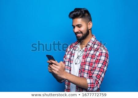 feliz · jovem · asiático · homem · telefone · móvel - foto stock © deandrobot