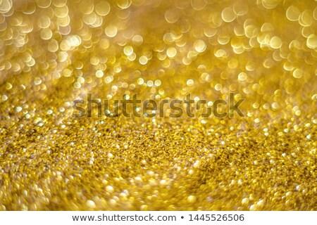 Christmas background radiate in golden Stock photo © marinini