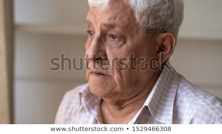 Serious thoughtful grey-haired elderly man Stock photo © ozgur