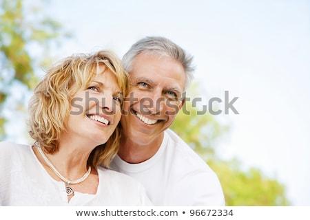 Retrato de una feliz pareja madura mirando Copyspace Foto stock © HannaMonika
