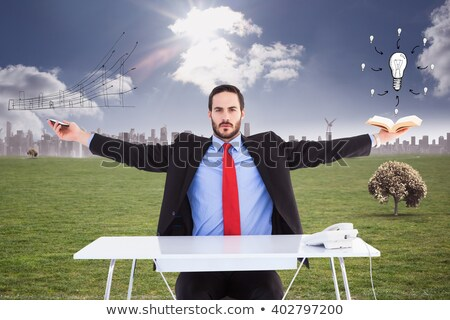 Unsmiling businessman standing with arms outstretched Stock photo © wavebreak_media