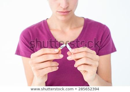Grave donna bionda sigaretta bianco donna felice Foto d'archivio © wavebreak_media