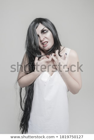 gothic woman with hands of vampire on her neck stock photo © master1305