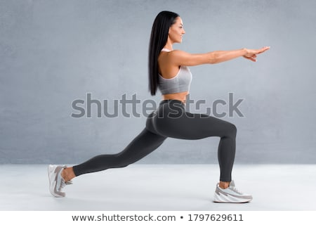 fitness woman doing stretching exercises stock photo © deandrobot