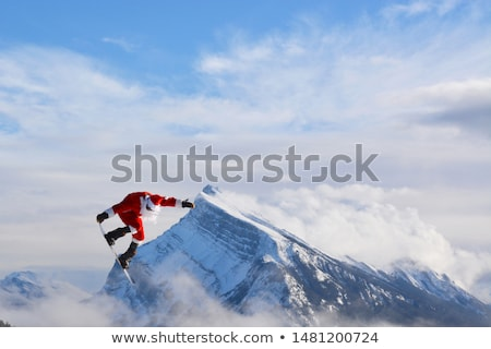 Kerstman snowboard vliegen Blauw sneeuw Rood Stockfoto © grivina