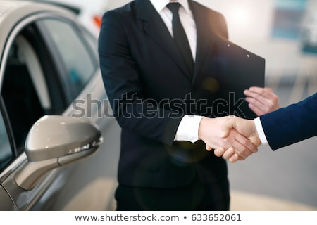 Dealer, female client and auto in car dealership Stock photo © Kzenon
