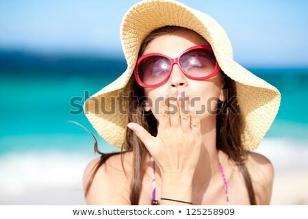 Beach sun hat woman blowing cute kiss on vacation Stock photo © Maridav
