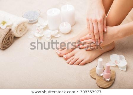 Nő láb francia pedikűr gyönyörű izolált Stock fotó © svetography
