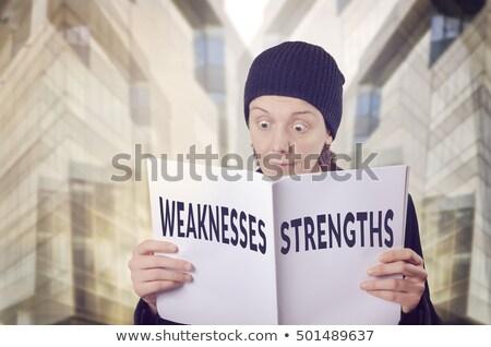 businessman reading swot analysis report stock photo © stevanovicigor