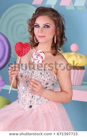 happy woman holding two red lollipops pin up retro style stock photo © artfotodima