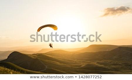 Siklórepülés naplemente illusztráció férfi szél ejtőernyő Stock fotó © adrenalina