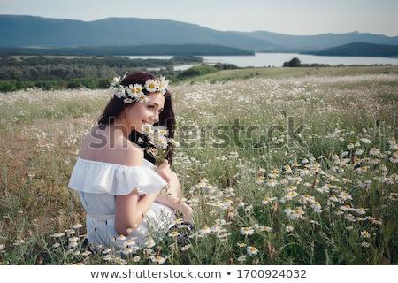 Woman with daisy Stock photo © pressmaster