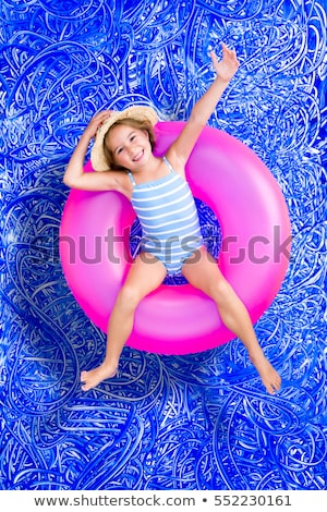 Confident happy little girl in a swimming pool Stock photo © ozgur