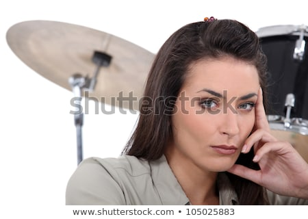 Stock photo: Beautiful woman playing drums onstage