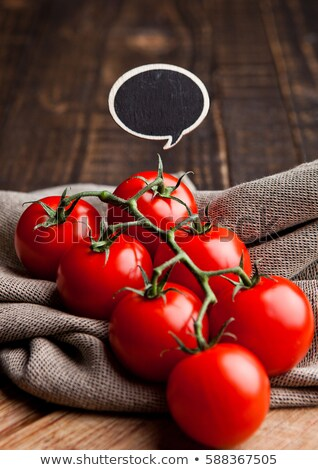 Fresh tomatoes with idea sign on kitchen towel Stock photo © DenisMArt