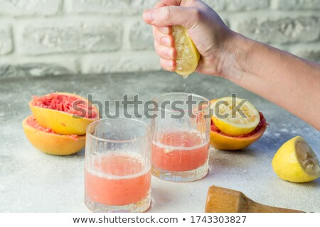 Grapefruit squeeze. Stock photo © Fisher
