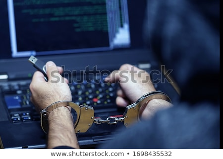 Arrested computer hacker with handcuffs Stock photo © stevanovicigor