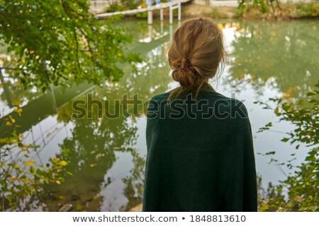 Silhouette of depressed sad woman standing by the lake Stock photo © stevanovicigor