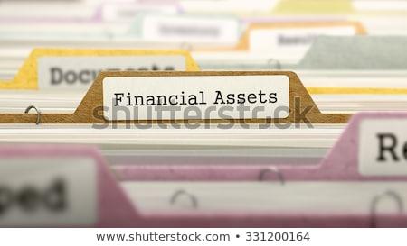 mappa · címke · tőke · pénz · toll · asztal - stock fotó © tashatuvango