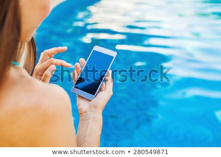 Stockfoto: Swimming Pool Mobile Phone App Copy Space