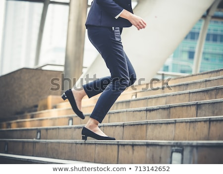 business woman running up the career ladder stock photo © rastudio