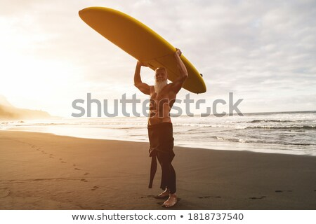 man on a surf in the sea Stock photo © OleksandrO