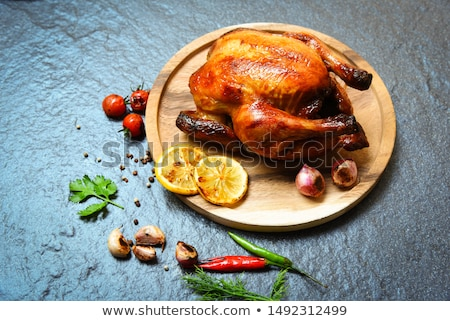Grilled chicken legs on cutting board.Rustic dinner background. stock photo © Virgin