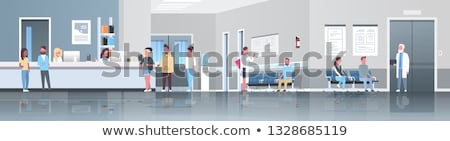 Nurse Standing In A Hospital Corridor stock photo © monkey_business