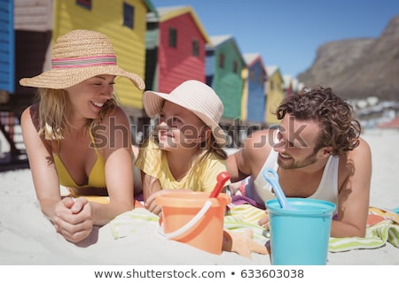 Children in front of beach huts Stock photo © IS2