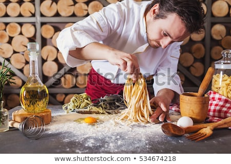 Male chef cooking pasta Stock photo © bluering