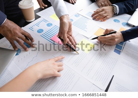 Table reading for business meeting with company statistics Stock photo © alphaspirit
