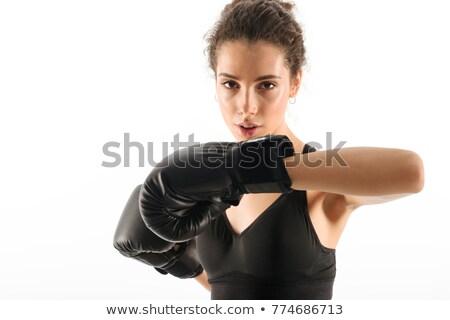 Koncentrált fürtös barna hajú fitnessz nő vonatok boxkesztyűk Stock fotó © deandrobot