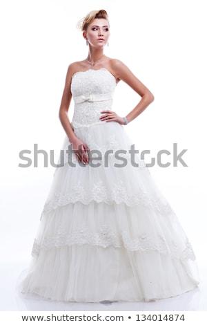 Fiatal csinos szőke nő visel esküvői ruha Stock fotó © dashapetrenko