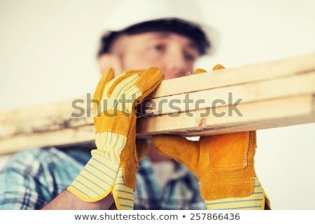 Workers Carrying Wooden Board Stock photo © derocz