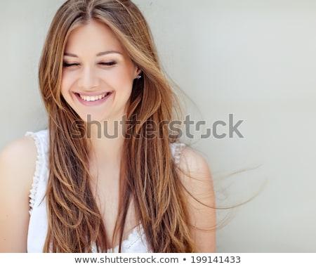 Mooie vrouw poseren geïsoleerd grijs gezicht gelukkig Stockfoto © hsfelix