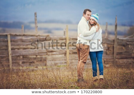 attractive young couple sharing a tender moment stock photo © iofoto