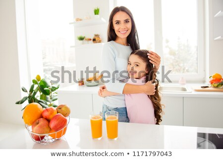Beautiful mum and her small little daughter hugging each other i Stock photo © dashapetrenko