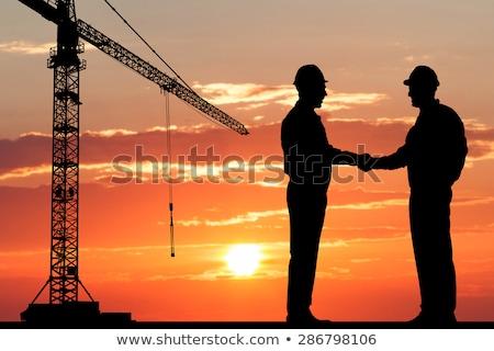 Silueta dos masculina arquitecto apretón de manos Foto stock © AndreyPopov