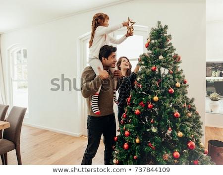anya · lánygyermek · díszít · karácsonyfa · vidám · karácsony - stock fotó © kzenon