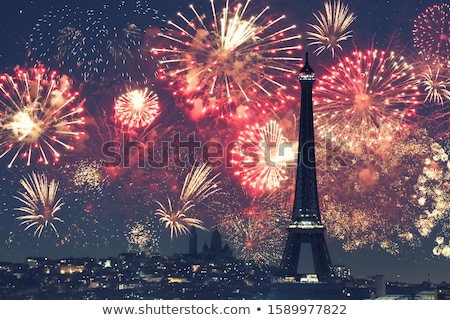 Illuminated Eiffel Tower at night in Paris Stock photo © vapi