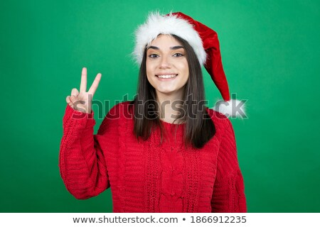 Image of two cheerful women wearing hats smiling at camera, isol Stock photo © deandrobot