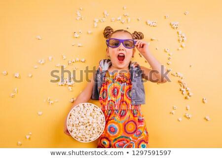 Little girl pipoca tv menina televisão criança Foto stock © Lopolo