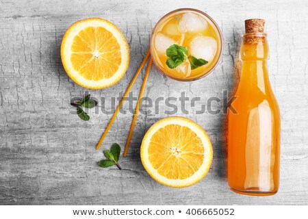 Fast Food and Soda or Juice in Bottles on Table Stock photo © robuart