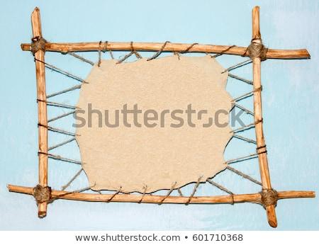 Caveman and wooden frame Stock photo © colematt