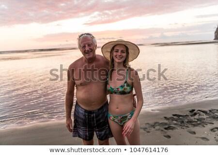 60-as évek férfi tengerpart jó idő lánygyermek Stock fotó © Lopolo